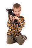 Smiling little boy holding his puppy Stock Photography