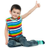Smiling little boy holding thumb up Royalty Free Stock Photography