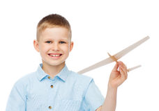 Smiling little boy holding a wooden airplane model Royalty Free Stock Photography