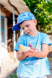 Smiling little boy holding a young chick Royalty Free Stock Image