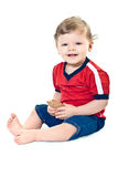 Smiling little boy holds on cookies Stock Image
