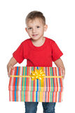 Smiling little boy holds a gift box Royalty Free Stock Images