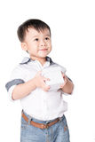 Smiling little boy holds a gift box Royalty Free Stock Photos