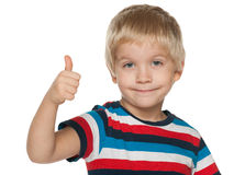 Smiling little boy holds his thumb up Royalty Free Stock Photos