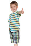 Smiling little boy holds his thumb up Royalty Free Stock Photography