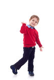 Smiling little boy in jeans Stock Photography