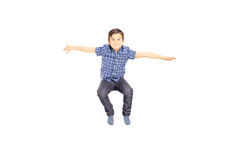 Smiling little boy jumping Royalty Free Stock Images