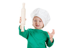 Smiling little boy kneading dough for the cookies, isolated on white Royalty Free Stock Images