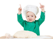 Smiling little boy kneading dough for the cookies, isolated on white Royalty Free Stock Photos
