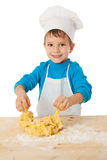Little boy kneading the dough Royalty Free Stock Images