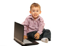 Smiling little boy with laptop Stock Photo