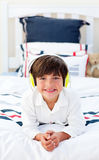 Smiling little boy listening music Royalty Free Stock Photography