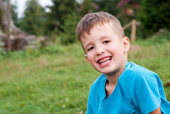 Smiling little boy outdoor stock image