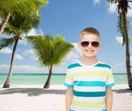 Smiling little boy over green background Royalty Free Stock Photography