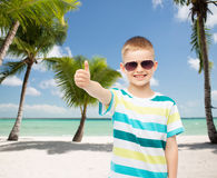 Smiling little boy over green background Stock Photos