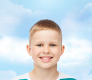 Smiling little boy over green background Royalty Free Stock Photo