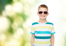 Smiling little boy over green background Stock Images