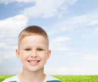 Smiling little boy over natural background Stock Image