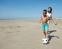 Smiling little boy playing with ball on beach Royalty Free Stock Image
