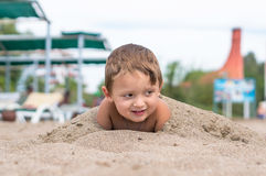 Smiling little boy playing in the sand. Positive human emotions, feelings, Stock Image