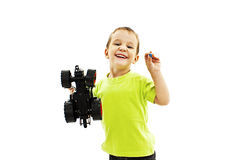 Smiling little boy playing with toy car Royalty Free Stock Photo