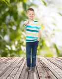 Smiling little boy pointing finger at you Royalty Free Stock Images