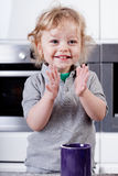 Smiling little boy preparing a meal Stock Images
