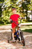 Smiling little boy riding bike Stock Images