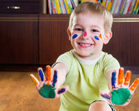 Smiling little boy showing his hands in paints Stock Image