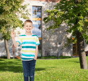Smiling little boy showing ok sign Stock Image