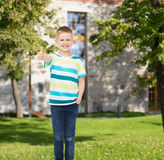 Smiling little boy showing thumbs up Stock Photos