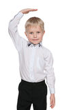 Smiling little boy shows how he is tall Royalty Free Stock Photography