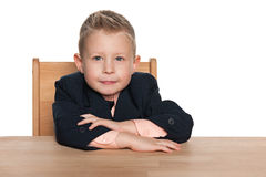 Little boy at the desk Royalty Free Stock Image
