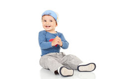 Smiling little boy sitting Royalty Free Stock Photography