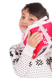 Smiling little boy with small Christmas gift box Stock Photo