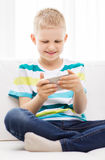 Smiling little boy with smartphone Royalty Free Stock Photography