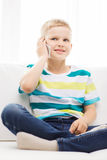 Smiling little boy with smartphone at home Royalty Free Stock Photography