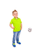 Smiling little boy with a soccer ball Stock Image