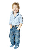 Smiling little boy standing and looking at camera Royalty Free Stock Photo