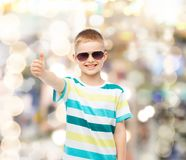 Smiling little boy in sunglasses showing thumbs up Royalty Free Stock Image