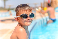 Smiling little boy in swimming goggles Stock Photography