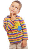 Smiling little boy thinking about Royalty Free Stock Image