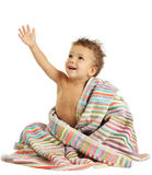 Smiling little boy in towel. Smiling little boy with wet head in towel Stock Image