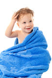 Smiling little boy in towel. Smiling little boy with wet head sitting in the towel, isolated on white Stock Photo