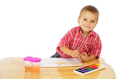 Smiling little boy with watercolor paintings Stock Photos