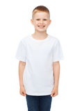 Smiling little boy in white blank t-shirt Royalty Free Stock Photos