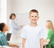 Smiling little boy in white blank t-shirt Stock Photos