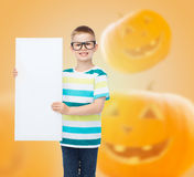 Smiling little boy with white board Stock Image