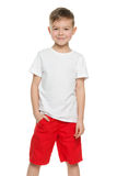 Smiling little boy in white shirt Royalty Free Stock Image