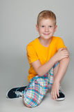Smiling little boy in the yellow shirt Royalty Free Stock Photos